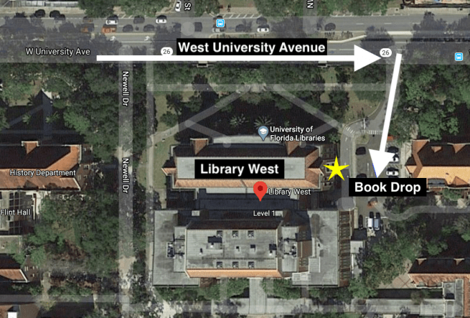 Aerial view of Library West, featuring the book drop in proximity to University Avenue
